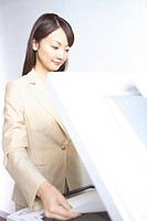 Japanese office lady taking a copy