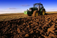Tractor tilling the land