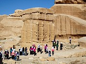 Jordanian pupils at the entance of the UNESCO World Heritage Site Al Siq. The entrance to the ancient Nabataean rock city of Petra, Jordan, Middle Eas...