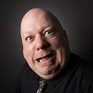 Bald man making a crazy face