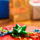 Presents wrapped and decorated with bows on a table.