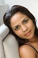 Head shot of woman looking at viewer