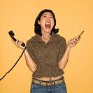 Yelling woman holding two phones