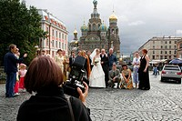 People posing for pictures in front of the Church on Spilled blood, St  Petersburg, Russia