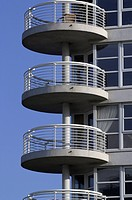 Round shaped balconies on the side of a residential development,
