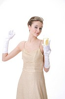 Teenage girl wearing crown holding a glass of beer