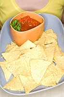 close up of tortilla chips with salsa