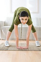 young woman doing streaching exercising