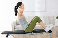 young woman doing sit_ups