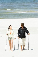 couple hiking on beach