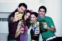 group friends drinking cocktails on a party