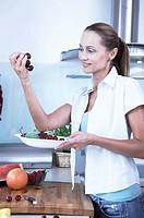 woman holding cherries