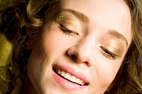 woman in golden make up