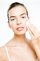 Woman putting up foundation