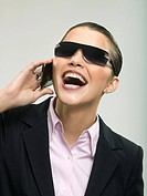 Businesswoman in sunglasses using cell phone
