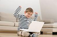 Little boy 4_5 using laptop