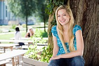Germany, Bavaria, Upper Bavaria, Young woman in beer garden, smiling, portrait