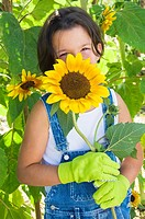Girl and sunflowers