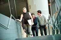 Germany, business people climbing stairs
