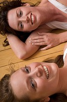 Two young women, smiling, portrait