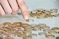 Person counting Euro coins, close up