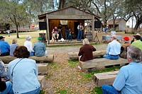 Audience enjoys Pleasant Family Country Band Performs at Cracker Country Florida living history museum located on the Florida State Fairgrounds Tampa