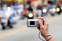 Daytona Beach Florida Biker Week motorcycle pilgrimage person taking picture with digital camera