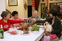 Chinese family at dinner table