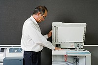 Man making photocopy in office