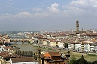 Aerial view of the old town of Florence with the Arno river and the Ponte Vecchio (Vecchio Bridge) with the bell tower of Palazzo Vecchio at a sunny d...
