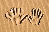 Imprint hands in sand