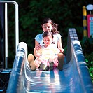 Girl 4_6 sitting on slide with Mother