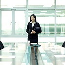 Businesswoman standing in front of conference room