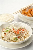 Cooked soybean sprout in white dish, a bowl of steamed rice, a plate of Chinese cuisine with chopsticks on it