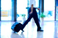 Businessman with luggage walking