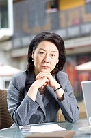 Businesswoman sitting at outdoors coffee shop