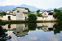 Traditional residential houses with reflection in the river, Hongcun village, Anhui Province, China, Asia