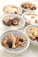 Mushroom chicken, four herb chicken, sesame oil chicken in the bowl