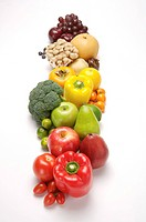 Close_up of a stack of fresh fruits and vegetables in a row