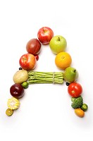 Fruits and vegetables in the shape of letter A, close_up