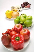 Different kinds of fruits and vegetables on the plates, close_up