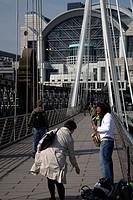 Musican busking Golden Jubilee Bridge Westminster London England