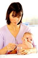 Woman preparing medication for baby