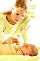 Woman putting drops in baby´s nose