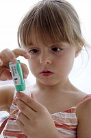 Little girl with medicines