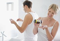 Woman taking vitamins in morning