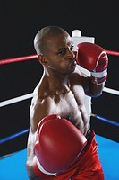 African boxer wearing red Boxing gloves ready to punch