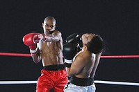 African boxer hitting his opponent