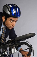 Close_up of a businessman cycling