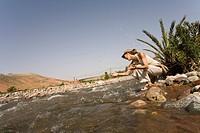 Woman river Marocco